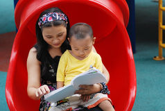 A mother and son reading  Royalty Free Stock Photo