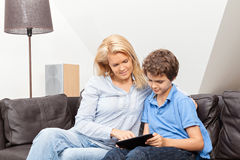 Mother and son reading Royalty Free Stock Photos