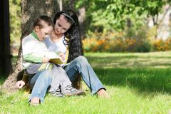 Mother and son reading book Stock Image