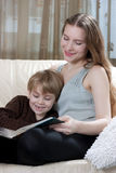 Mother and son reading book Stock Photography
