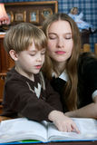 Mother and son reading book Stock Images