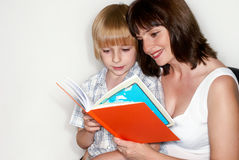 Mother with the son reading the book Stock Image