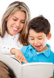 Mother and son reading a book Stock Photography