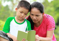 Mother and son reading a book Stock Image