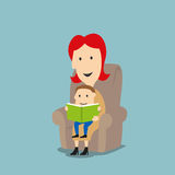 Mother and son reading book in armchair Royalty Free Stock Photography