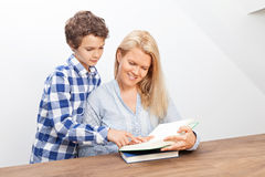 Mother and son are reading Royalty Free Stock Image