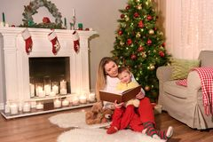 Mother and son reading a book in a new year stock photo