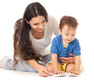 Mother and son reading book together isolated Royalty Free Stock Image