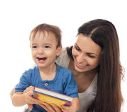 Mother and son reading book together isolated Stock Photo
