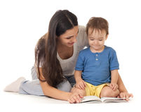 Mother and son reading book together isolated Stock Image