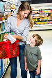 Mother and son reading shopping list Stock Image
