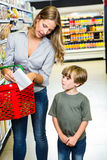 Mother and son reading shopping list Royalty Free Stock Image