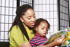 Mother and son reading together Royalty Free Stock Photography