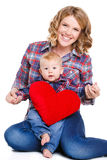 Mother and son with red heart-shaped pillow royalty free stock image