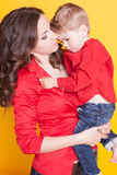 Mother and son in red shirts stock photography