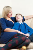 Mother and Son on a Couch Stock Images