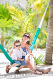 Mother and son relaxing in hammock Stock Photography