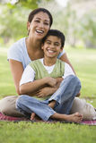 Mother and son relaxing in park. Looking to camera royalty free stock images