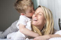 Mother And Son Relaxing Together In Bed Royalty Free Stock Image