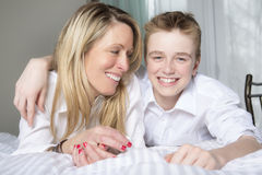 Mother And Son Relaxing Together In Bed Royalty Free Stock Images