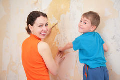 Mother with son remove old wallpapers Stock Images
