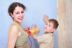 Mother and son repair room Royalty Free Stock Photo