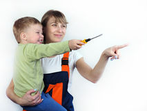 Mother and son are repairing the apartment Royalty Free Stock Image