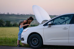 Mother and Son Repairing Something on their Car Stock Photos