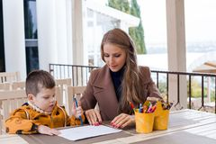 Mom with boy draw colored pencils Royalty Free Stock Images