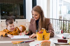 Mom with boy draw colored pencils Stock Photo