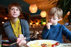 Mother with son in restaurant Stock Photography