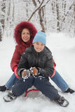 Mother, son ride on sled Stock Photo
