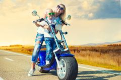 Mother and son rides on motorbike. Hobbies to ride a scooter stock images