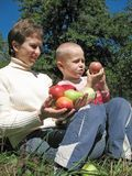 Mother and son with ripe apples Royalty Free Stock Photo
