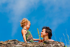 Mother and son on the rock. Mother and young son on the rock Royalty Free Stock Photos