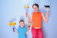 Mother and son with rollers and brushes Royalty Free Stock Photography
