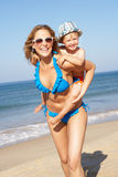 Mother And Son Running Along Beach Royalty Free Stock Photo