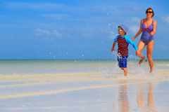 Mother and son running on the beach Stock Photography