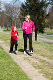 Mother with the son running on park Stock Images