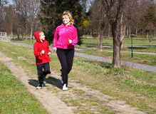Mother with the son running on park Royalty Free Stock Photography