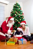 Mother and son with Santa Stock Photography