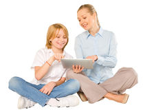 Mother and son sat on floor with tablet Stock Photo