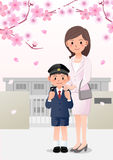 Mother and son on school background under cherry blossom trees Stock Images