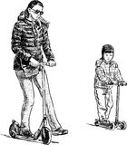 Mother and son on the scooters Stock Photography