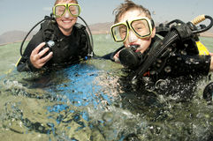 Mother and son scuba dive