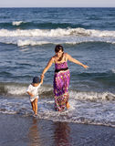 Mother with son at sea Stock Photography