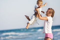 Mother and son on sea background Stock Photo