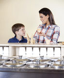 Mother And Son Selecting Between Cones And Cups Royalty Free Stock Photography
