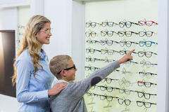 Mother and son selecting spectacles from display Stock Photo