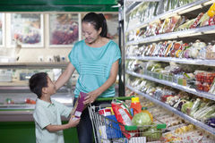 Mother and son shopping for groceries in supermarket, Beijing Royalty Free Stock Photo
